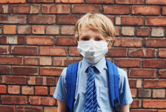 schoolboy in mask